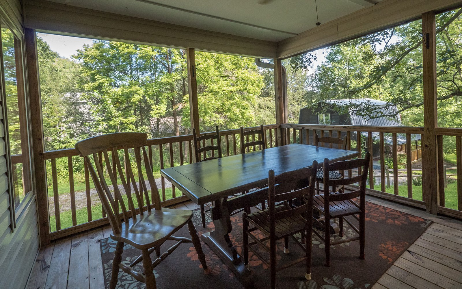 Dining on screened porch Hilt St house